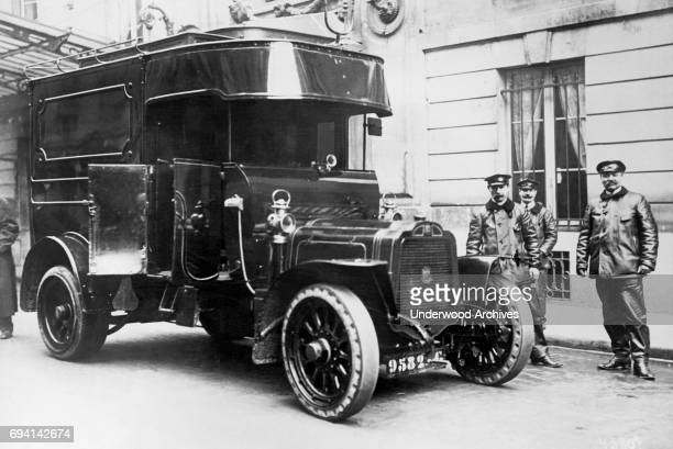 Portrait of a group of bank guards and their armored car Paris France circa 1913 The armored truck was brought into service as a result of recent...