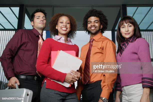 Portrait of a group of business executives smiling