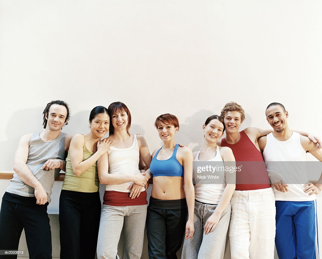 Portrait of a Group of Dancers Standing in a Line : Stock Photo