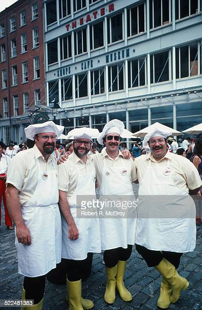 Portrait of a group of four chefs in uniform, who work in the South Street Seaport area, New York, New York, July 31, 1983.