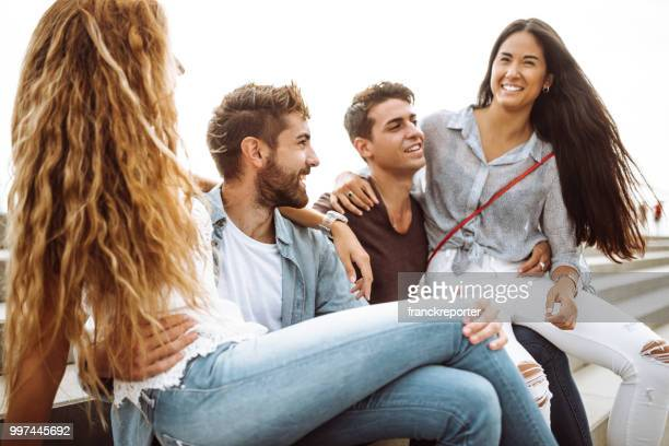 portrait of a group of friends all together sitting