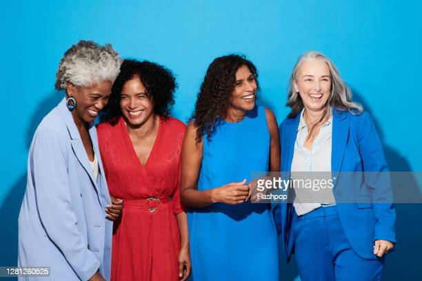 portrait of a group of mature women against a blue background - white caucasian stock pictures, royalty-free photos & images