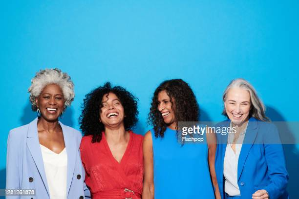 portrait of a group of mature women against a blue background - only women stock pictures, royalty-free photos & images