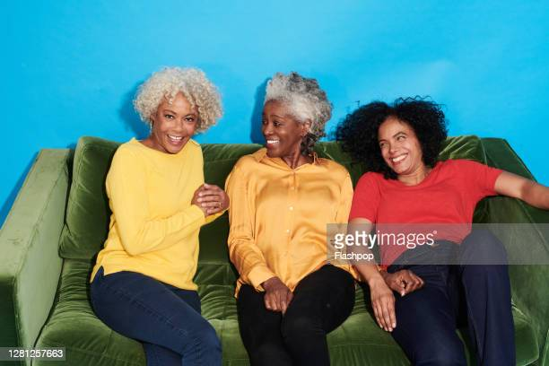 portrait of a group of mature women sitting on a sofa together - sofa stock pictures, royalty-free photos & images