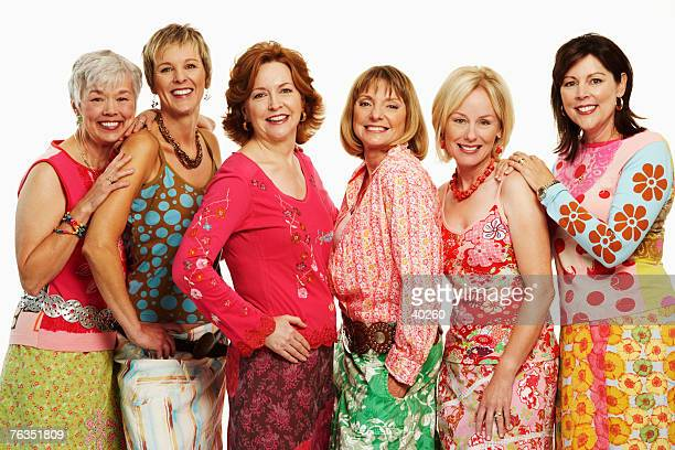 portrait of a group of mature women standing together and smiling - older women in short skirts stock pictures, royalty-free photos & images