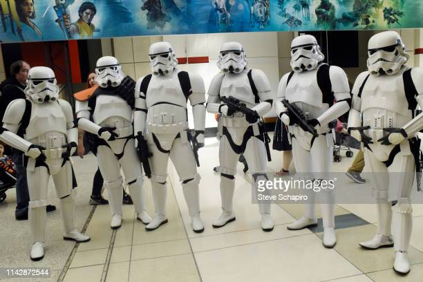 Portrait of a group of people dressed as 'Stormtroopers' at the Star Wars Celebration event at Wintrust Arena, Chicago, Illinois, April 13, 2019.