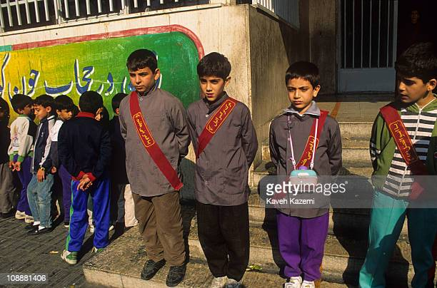 Portrait of a group of primary school boys with sashes that have anti-Isreali sloguns on them pinned to their tunics, Tehran, Iran, October 2, 1997.