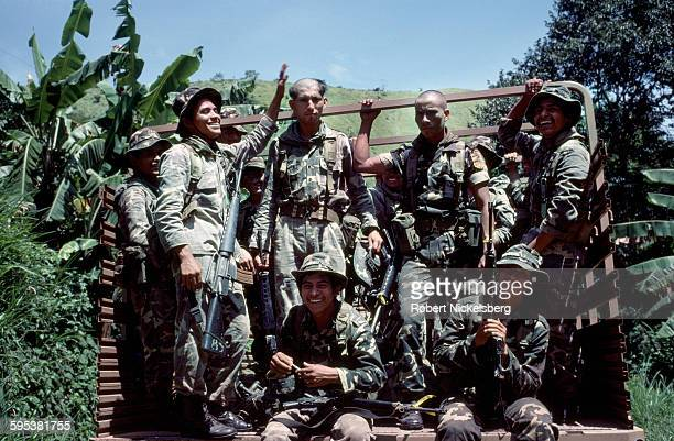 Portrait of a group of Salvadoran soldiers of the Atlacatl Battalion as they pose in the back in a truck in San Miguel Province El Salvador August 1...