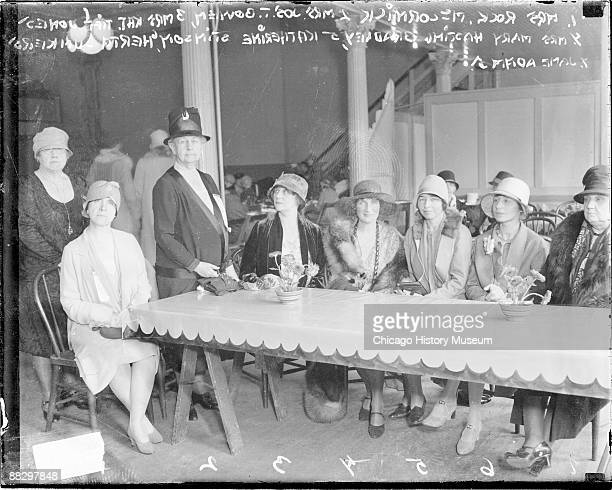 Portrait of a group of seven women all social activists sitting and standing at a long table in a room in Chicago Illinois 1928 Mrs Joseph T Bowen is...