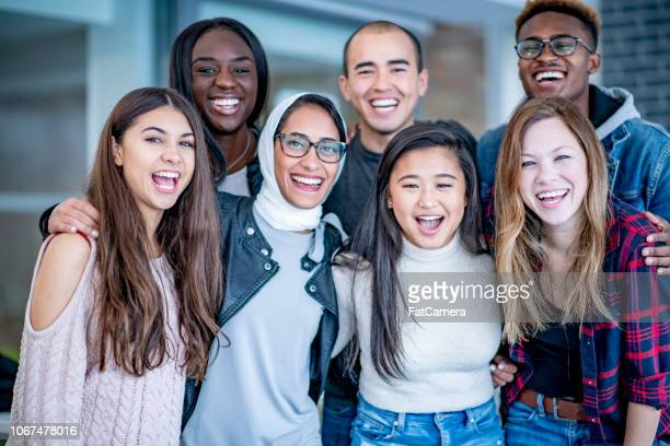 portrait of a group of students with bright smiles - university student stock pictures, royalty-free photos & images