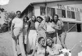 Portrait of a group of unidentified people as they pose on the beach picture id116359628?s=170x170