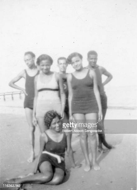 Portrait of a group of unidentified people as they pose on the beach at the edge of Idlewild Lake Idlewild Michigan September 1938 Idlewild known as...