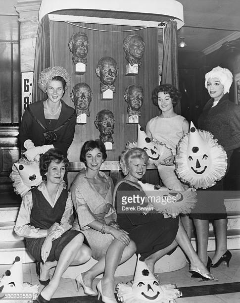 Portrait of a group of West End actresses unveiling busts of the Crazy Gang designed by Gianni Franzosi Millicent Martin Beryl Grey Elizabeth Seal...