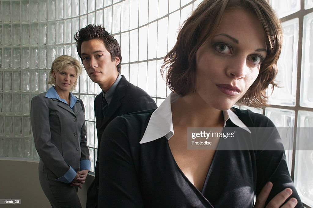 portrait of a group of young business people as they look seriously at the camera : Stockfoto
