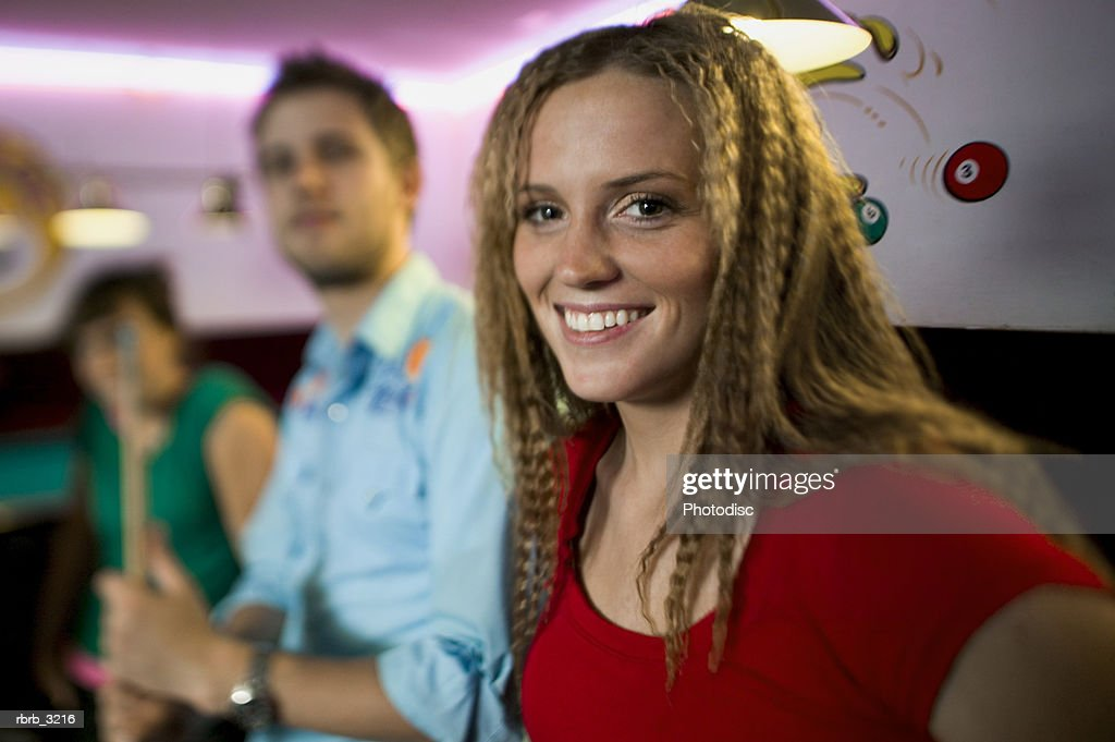 Portrait of a group of young people at a pool hall : Foto de stock