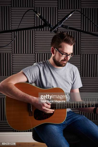 Portrait of a guitarist recording a song with a pair of AKG Perception Live P17 microphones taken on April 13 2016
