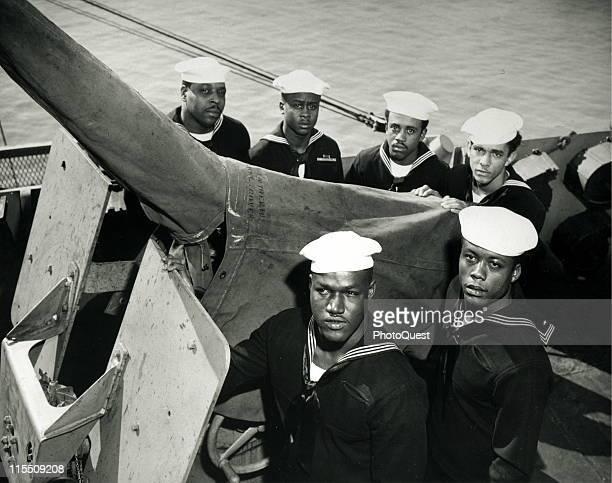 Portrait of a gun crew of six African American sailors clockwise from top left Jonell Copeland Que Gant Harold Clark Jr James Eddie Dockery Alonzo...