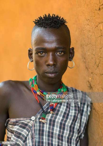 Portrait of a Hamer tribe teenage boy Omo valley Turmi Ethiopia on June 5 2017 in Turmi Ethiopia