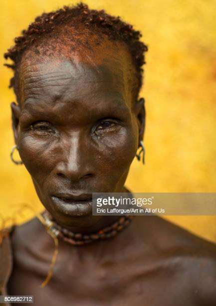 Portrait of a Hamer tribe woman with red ochre on the face Omo valley Turmi Ethiopia on June 5 2017 in Turmi Ethiopia