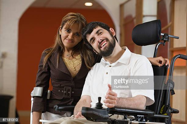 portrait of a handicapped man and woman smiling - developmental disability stock photos and pictures