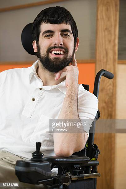 portrait of a handicapped mature man smiling - paralisia cerebral - fotografias e filmes do acervo