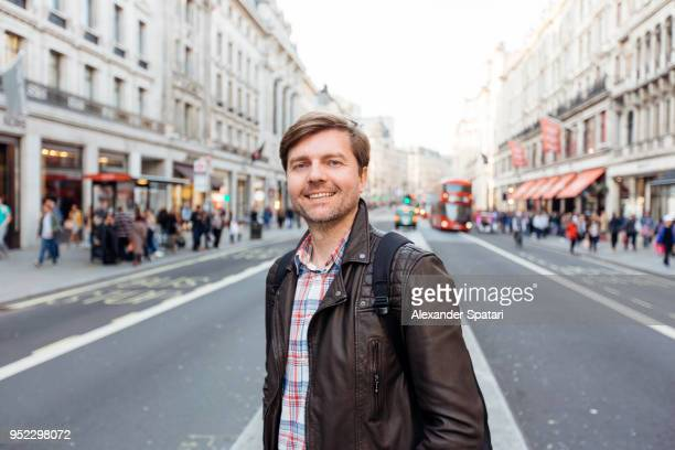 portrait of a handsome man on the streets of london, england, uk - one mature man only stock photos and pictures