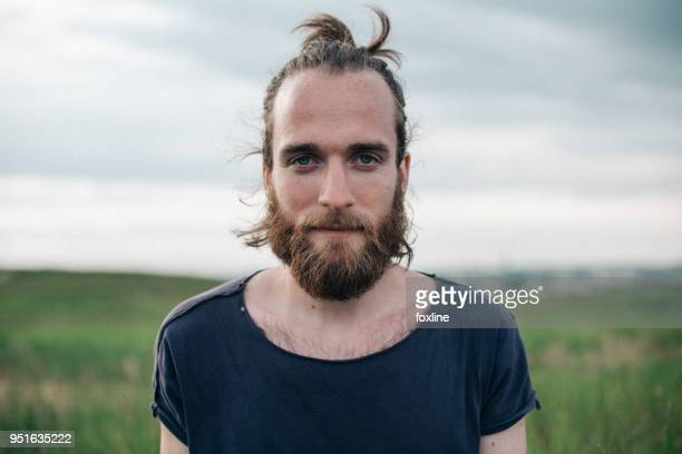 Portrait of a handsome man with a top knot
