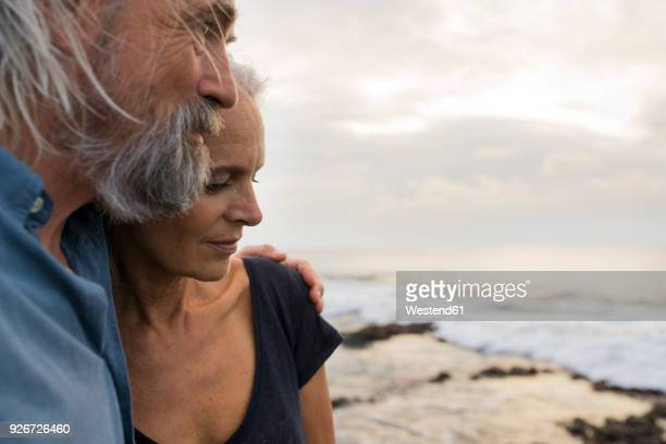 Portrait of a handsome senior couple at the sea