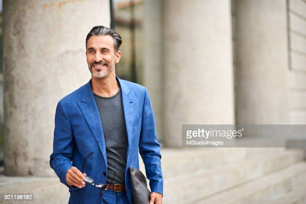 portrait of a handsome smiling man - well dressed stock pictures, royalty-free photos & images