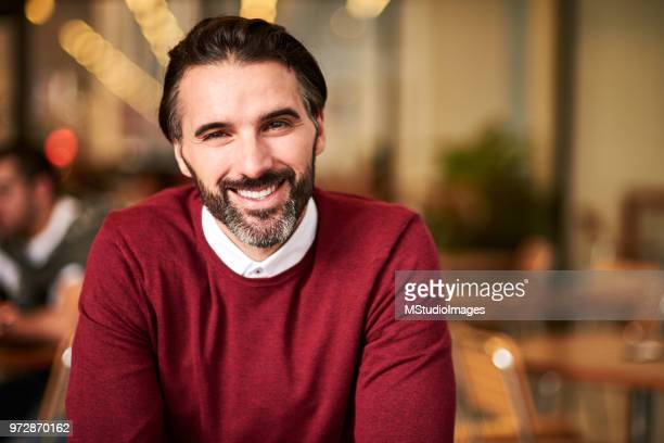 portrait of a handsome smiling man - handsome mexican men stock pictures, royalty-free photos & images