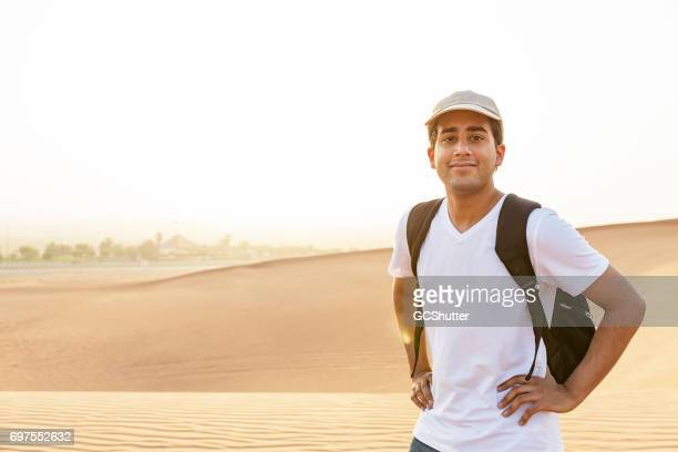 Portrait of a handsome teenager at Dunes of Arabia