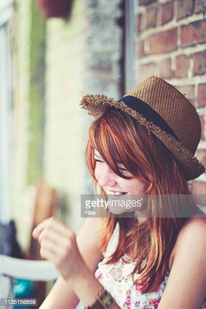 portrait of a handsome teenager with red dyed hair, blue eyes and straw hat - one teenage girl only stock pictures, royalty-free photos & images