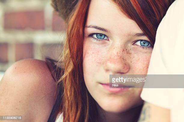 portrait of a handsome teenager with red dyed hair, blue eyes - one teenage girl only stock pictures, royalty-free photos & images