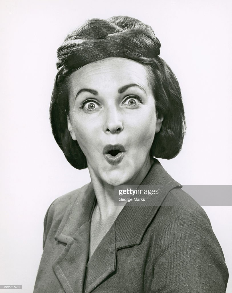 Portrait of a happily surprised woman : Stock Photo