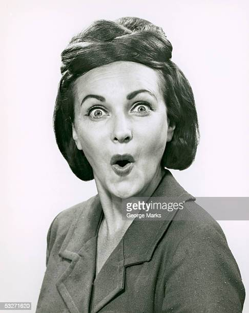 Portrait of a happily surprised woman