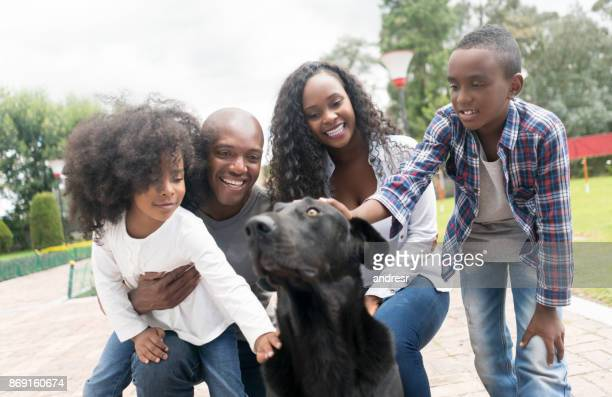 Portrait of a happy African American family adopting a dog