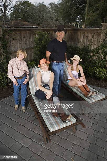Portrait of a happy American family on deck chairs