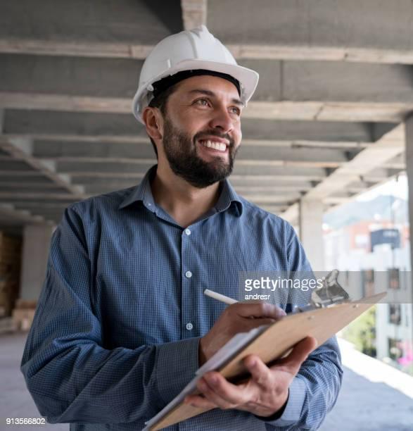 Portrait of a happy architect at a construction site