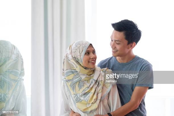 portrait of a happy asian couple - muslim couple stock pictures, royalty-free photos & images