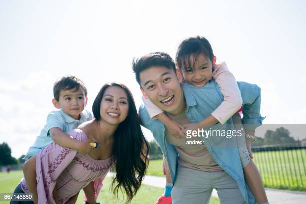 Portrait of a happy Asian family at the park