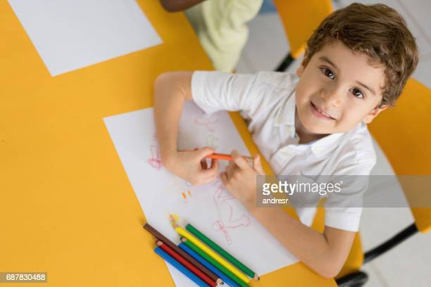 portrait of a happy boy at school coloring - color pencil stock pictures, royalty-free photos & images