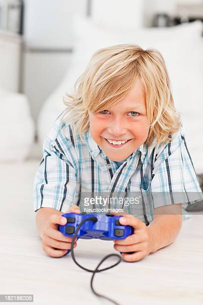 Portrait of a happy boy playing video game