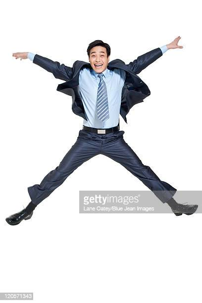 portrait of a happy businessman - legs apart stock pictures, royalty-free photos & images