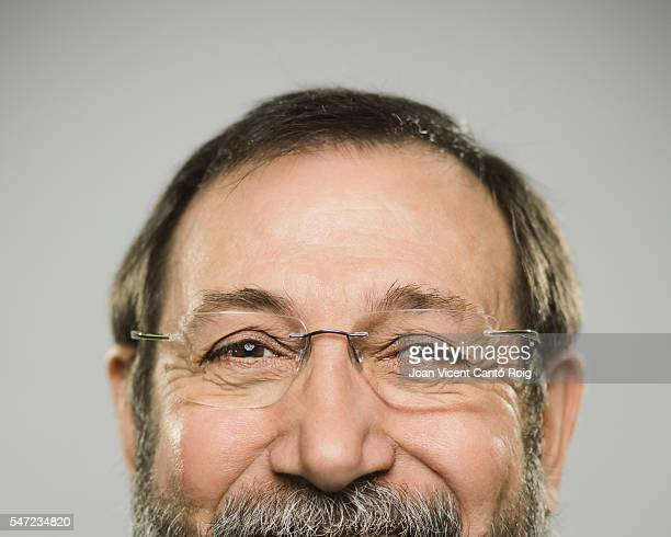 Portrait of a happy caucasian man with glasses and beard.