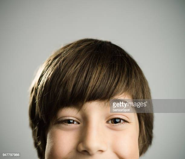 Portrait of a happy caucasian real boy looking at camera.