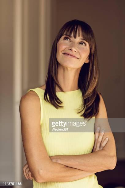 portrait of a happy, confident woman - one mature woman only stock-fotos und bilder