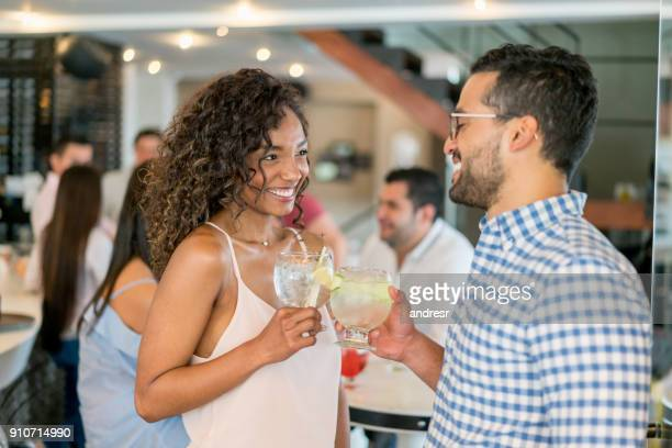 Portrait of a happy couple having drinks at a bar
