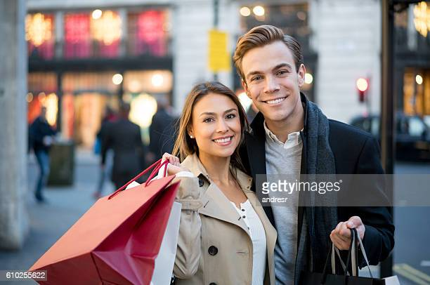 Portrait of a happy couple shopping