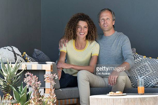 Portrait of a happy couple sitting on a couch