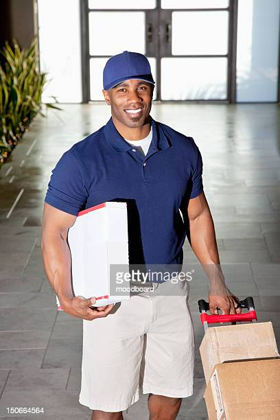 Portrait of a happy delivery man with packages